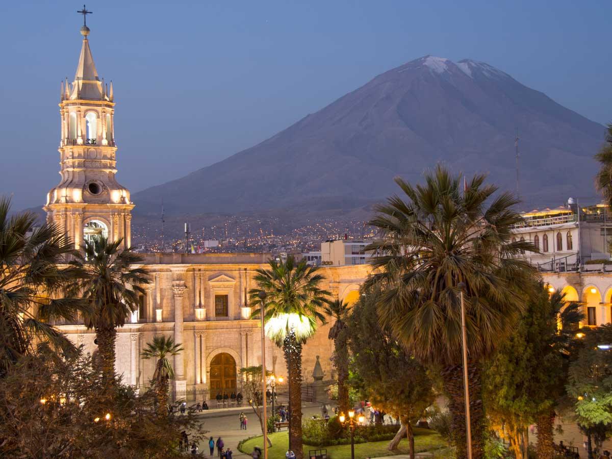 Iconic view of Arequipa Basilica and Misti Volcano after sunset
